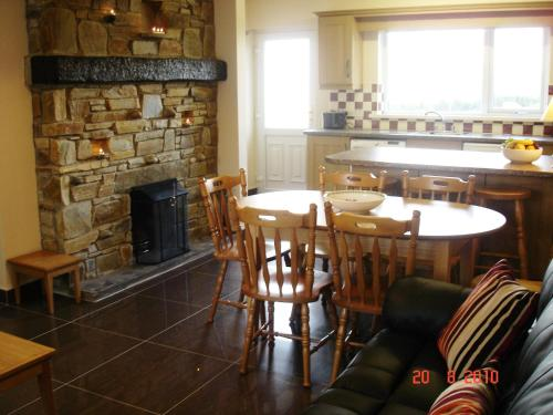 A restaurant or other place to eat at Bradleys Cottage Creeslough