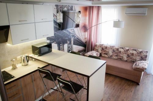 Кухня или мини-кухня в Апартаменты на Лесной