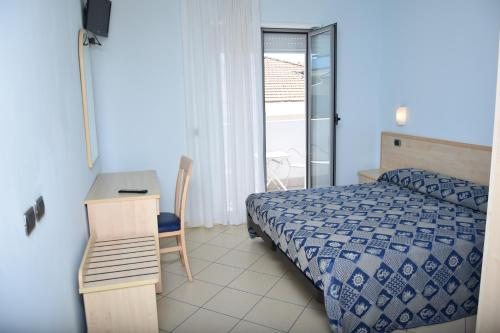 Letto o letti in una camera di Hotel Antares