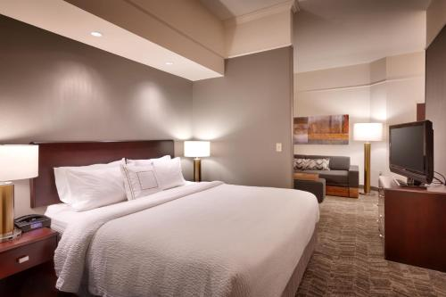 A bed or beds in a room at SpringHill Suites Thatcher