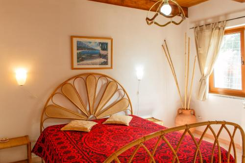 A bed or beds in a room at Apartments Villa Michela
