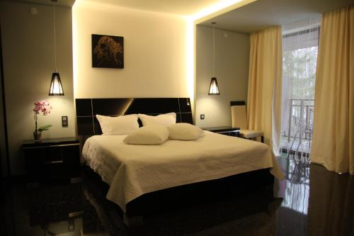A bed or beds in a room at MONA Boutique Hotel Sheremetyevo