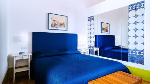 A bed or beds in a room at Donna Giulia, Luxury House - Mini Hotel