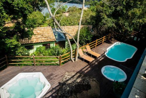 Вид на бассейн в Ecoresort Refúgio Cheiro de Mato или окрестностях