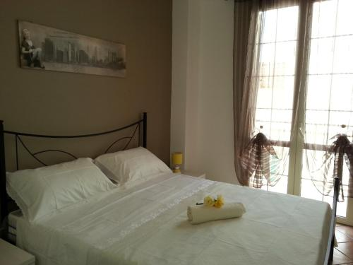 A bed or beds in a room at Casa Vacanze Chiara