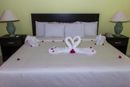 A bed or beds in a room at Starfish St Lucia - All Inclusive