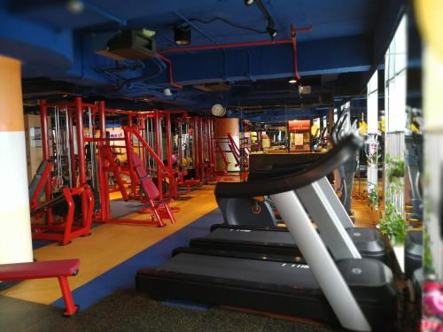 The fitness center and/or fitness facilities at The Legend Nuomo Service Apartment