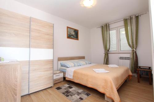 Posteľ alebo postele v izbe v ubytovaní Apartment Stipe