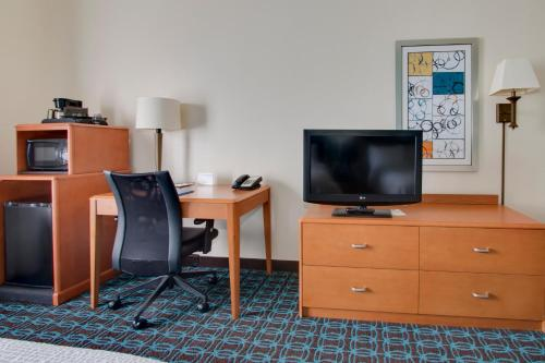 A television and/or entertainment center at Fairfield Inn & Suites Clermont