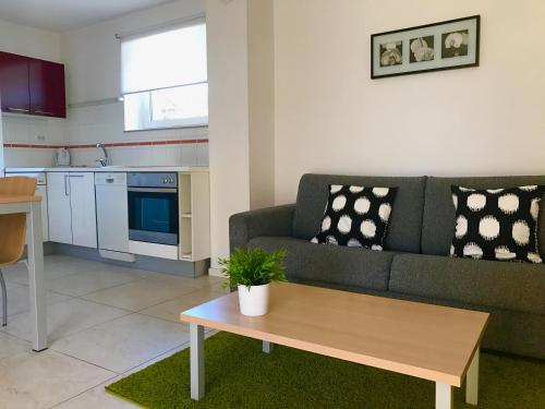 A seating area at Apartments Lucija