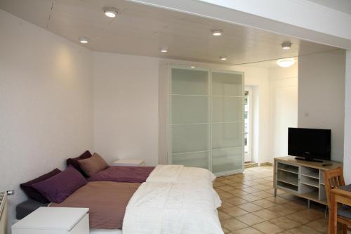 Ein Bett oder Betten in einem Zimmer der Unterkunft Ferienwohnung Odenkirchen