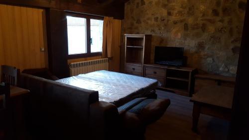 Cama o camas de una habitación en Apartamentos Numancia