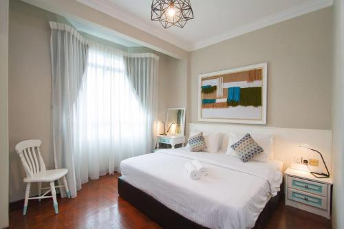 A bed or beds in a room at Century Bay Private Residences