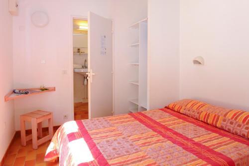 Un ou plusieurs lits dans un hébergement de l'établissement Village Vacances La Manne