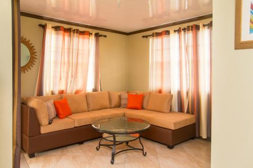 A seating area at Believe Caribbean Apartment