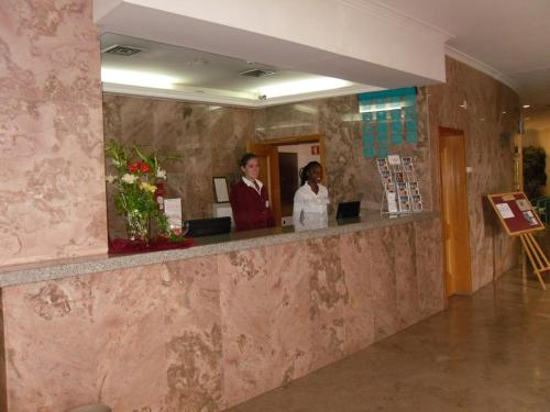 Staff members at Grande Hotel Dom Dinis