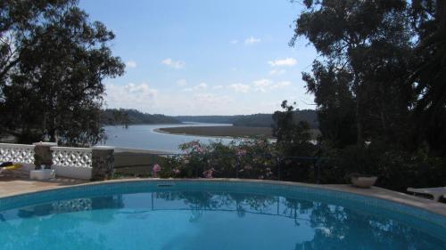 The swimming pool at or near Moinho Da Asneira