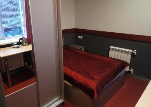 Кровать или кровати в номере Отель 33 Медведя