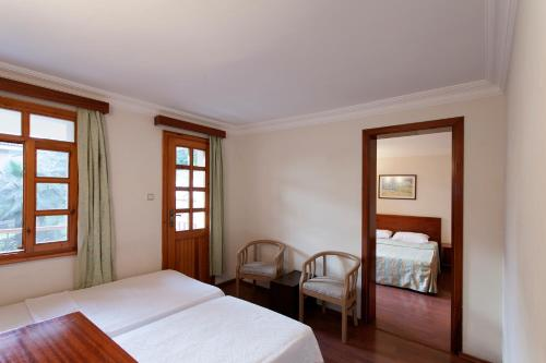 A bed or beds in a room at Perdikia Beach