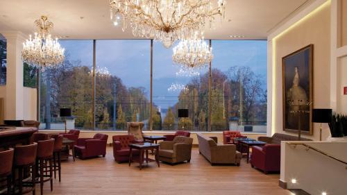 Een restaurant of ander eetgelegenheid bij Austria Trend Parkhotel Schönbrunn Wien