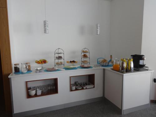 A cozinha ou kitchenette de Hotel Bonjardim