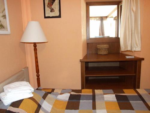 Кровать или кровати в номере Apartman Basilica
