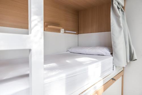Cama o camas de una habitación en The Loft Hostel