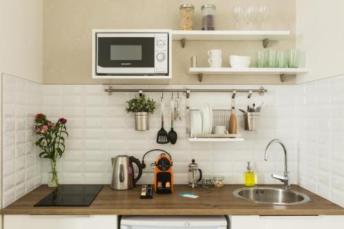 Кухня или мини-кухня в Апартаменты География