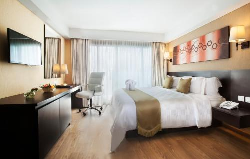 A bed or beds in a room at Best Western Premier The Hive
