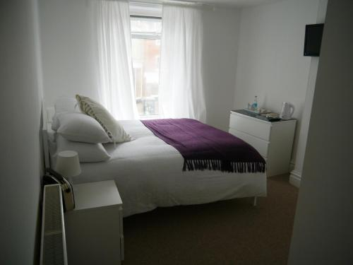 A bed or beds in a room at The Crown Rooms Newmarket