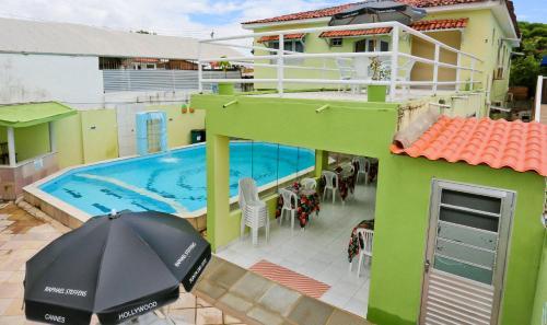 Uma vista da piscina em Pousada Casa Porto ou nos arredores