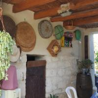 Traditional village stone house outdoor courtyard, hotel in Simou