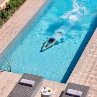 Elaia Luxury Suites Lagonisi, отель в Лагонисси