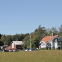 Tavlebords Honungsgård, hotell i Tegneby