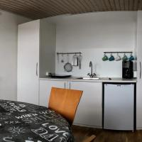 2 rooms, private kitchen, bathroom, and garden.