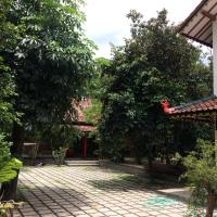 "RedDoorz Hostel near Adisucipto Airport Yogyakarta </h2 </a <div class=sr-card__item sr-card__item--badges <div class=sr-card__item__review-score style=padding: 8px 0  <div class=bui-review-score c-score bui-review-score--inline bui-review-score--smaller <div class=bui-review-score__badge aria-label=Skor 8,4  8,4 </div <div class=bui-review-score__content <div class=bui-review-score__title Sangat baik </div <div class=bui-review-score__text 11 ulasan </div </div </div   </div </div <span data-et-view=NAFLeOeJOMOQeOESJMWSFEDacWXT:1 </span <div class=sr-card__item   data-ga-track=click data-ga-category=SR Card Click data-ga-action=Hotel location data-ga-label=book_window: 10 day(s)  <svg aria-hidden=true class=bk-icon -streamline-geo_pin sr_svg__card_icon focusable=false height=12 role=presentation width=12<use xlink:href=#icon-streamline-geo_pin</use</svg <div class= sr-card__item__content   , Yogyakarta •  dari Catur Tunggal </div </div </div <div data-component=deals-container data-deals=[{""b_value_user_currency"":""TL\u00a015,03"",""b_raw_value_user_currency"":15.033476268597,""b_copy"":""Promo Travel"",""b_copy_alt"":""Anda mendapat pengurangan harga karena akomodasi ini menawarkan diskon."",""b_type"":""Sales Campaigns"",""b_raw_value_user_currency_rounded"":15.0,""b_value_user_currency_rounded"":""TL\u00a015""}] data-deals-other=[{""b_copy_alt"":""Akomodasi ini menawarkan diskon 15% atau lebih untuk beberapa harga kamar yang dipesan antara 10 Maret 2020 dan 4 Januari 2021 dengan tanggal menginap antara 1 Juni 2020 dan 4 Januari 2021."",""b_copy"":""Promo Travel"",""b_type"":""Getaway 2020""}] data-layout=horizontal data-max-elements=3 data-no-tooltips=1 data-use-drawer= data-prevent-propagation=0 class=c-deals-container  data-et-click= customGoal:OMeRQWNOTVUUADFQTXWDTSfCSRBDHT:1   <div class=c-deals-container__inner-box    <div class=c-deals-container__badge-box c-deals-container__badge-box_inline <span tabindex=0  <span class=bui-badge bui-badge--callout data-bui-component=Badge <span class=bui-badge__textPromo Travel</span </span </span </div </div </div <div class= sr-card__price m_sr_card__price_with_unit_name sr-card-color-constructive-dark   <div class=m_sr_card__price_unit_name m_sr_card__price_small m_sr_card__price_unit_name-bold  data-et-view=HZUGOQQBSXVVFEfVafFRWe:1 2 x Tempat Tidur Single di Kamar Asrama Campuran </div <div class=mpc-wrapper bui-price-display mpc-sr-default-assembly-wrapper <div class=mpc-ltr-right-align-helper sr_price_wrap <div class=bui-price-display__original mpc-color_dark-green-helper mpc-inline-block-maker-helper  aria-hidden=true onclick=event.preventDefault(); data-component=tooltip data-tooltip-text=Anda dapat diskon karena akomodasi ini menawarkan potongan harga untuk beberapa kamar yang cocok dengan pencarian Anda. data-et-click= customGoal:OMeRQWNOTOOIeZNBAFVNaRe:1   TL 60 </div <div class=prco-js-headline-price mpc-inline-block-maker-helper bui-price-display__value mpc-color_dark-green-helper data-et-click= customGoal:OMeRQWNOTOOIeZNBAFVNaRe:2   TL 44 </div </div <div class=mpc-ltr-right-align-helper <div class=prd-taxes-and-fees-under-price mpc-inline-block-maker-helper blockuid- data-cur-stage=1 data-excl-charges-raw=  termasuk pajak dan biaya lainnya </div </div </div  <p class=  m_sr_card_policies bui-f-color-constructive  css-loading-hidden e2e-free-cancellation  data-et-view=HZUGOQQBSXVVFEfVafFRWe:1 HZUGOQQBSXVVFEfVafFRWe:2   <span class=sr-card__item--strongPembatalan GRATIS</span   </p <p class=  m_sr_card_policies bui-f-color-constructive  css-loading-hidden e2e-no-prepayment  <span class=u-display-block u-font-weight-boldTANPA UANG MUKA</span - bayar di tempat </p  </div </div </div </li <li id=hotel_385049 data-is-in-favourites=0 data-hotel-id='385049' class=sr-card sr-card--arrow bui-card bui-u-bleed@small js-sr-card m_sr_info_icons card-halved card-halved--active   <div data-href=/hotel/id/rumah-nugraha.id.html?label=gen173nr-1FCAQoggJCCmRpc3RyaWN0X1hIElgEaOQBiAEBmAESuAEYyAEF2AEB6AEB-AEDiAIBqAIEuAKaocr8BcACAdICJDMxMjU0N2UyLWJjYTYtNDFhZi1hZWJmLTRiOGQyZTNhNmZkN9gCBeACAQ&sid=0dcdb580ad6709ca20a25f28ada458de&all_sr_blocks=38504905_256715199_2_0_0&checkin=2020-11-02&checkout=2020-11-03&dest_type=district&group_adults=2&group_children=0&hapos=16&highlighted_blocks=38504905_256715199_2_0_0&hpos=16&nflt=pri%3D&no_rooms=1&sr_order=price&sr_pri_blocks=38504905_256715199_2_0_0__8342799&srepoch=1603440794&srpvid=2a0439cda64c0018&ucfs=1&matching_block_id=38504905_256715199_2_0_0&srhp=1&ref_is_wl=1 onclick=window.open(this.getAttribute('data-href')); target=_blank class=sr-card__row bui-card__content data-et-click=  <div class=sr-card__image js-sr_simple_card_hotel_image has-debolded-deal js-lazy-image sr-card__image--lazy data-src=https://cf.bstatic.com/xdata/images/hotel/square200/250504588.jpg?k=7889b65c247843213b7b4f6a6f87833d2baef229afb3d2e1aa9d13a8228830c7&o=&s=1,https://cf.bstatic.com/xdata/images/hotel/max1024x768/250504588.jpg?k=27c06904ab3e05358d966e499bf7b9db916d54f9c0146537821d820c8625d561&o=&s=1  <div class=sr-card__image-inner css-loading-hidden </div <noscript <div class=sr-card__image--nojs style=background-image: url('https://cf.bstatic.com/xdata/images/hotel/square200/250504588.jpg?k=7889b65c247843213b7b4f6a6f87833d2baef229afb3d2e1aa9d13a8228830c7&o=&s=1')</div </noscript </div <div class=sr-card__details data-et-click=  <div class=sr-card_details__inner <a href=/hotel/id/rumah-nugraha.id.html?label=gen173nr-1FCAQoggJCCmRpc3RyaWN0X1hIElgEaOQBiAEBmAESuAEYyAEF2AEB6AEB-AEDiAIBqAIEuAKaocr8BcACAdICJDMxMjU0N2UyLWJjYTYtNDFhZi1hZWJmLTRiOGQyZTNhNmZkN9gCBeACAQ&sid=0dcdb580ad6709ca20a25f28ada458de&all_sr_blocks=38504905_256715199_2_0_0&checkin=2020-11-02&checkout=2020-11-03&dest_type=district&group_adults=2&group_children=0&hapos=16&highlighted_blocks=38504905_256715199_2_0_0&hpos=16&nflt=pri%3D&no_rooms=1&sr_order=price&sr_pri_blocks=38504905_256715199_2_0_0__8342799&srepoch=1603440794&srpvid=2a0439cda64c0018&ucfs=1&matching_block_id=38504905_256715199_2_0_0&srhp=1&ref_is_wl=1 onclick=event.stopPropagation(); target=_blank <h2 class=sr-card__name u-margin:0 u-padding:0 data-ga-track=click data-ga-category=SR Card Click data-ga-action=Hotel name data-ga-label=book_window: 10 day(s)  SPOT ON 2419 Rumah Nugraha Hotel Syariah </h2 </a <div class=sr-card__item sr-card__item--badges <div class= sr-card__badge sr-card__badge--class u-margin:0  data-ga-track=click data-ga-category=SR Card Click data-ga-action=Hotel rating data-ga-label=book_window: 10 day(s)  <span class=c-accommodation-classification-rating <span class=c-accommodation-classification-rating__badge c-accommodation-classification-rating__badge--stars   <span class=bui-rating bui-rating--smaller role=img aria-label=2 out of 5 <span aria-hidden=true class=bui-icon bui-rating__item bui-icon--medium role=presentation <svg xmlns=http://www.w3.org/2000/svg viewBox=0 0 24 24 focusable=false aria-hidden=true role=img <path d=M23.555,8.729a1.505,1.505,0,0,0-1.406-.98H16.062a.5.5,0,0,1-.472-.334L13.405,1.222a1.5,1.5,0,0,0-2.81,0l-.005.016L8.41,7.415a.5.5,0,0,1-.471.334H1.85A1.5,1.5,0,0,0,.887,10.4l5.184,4.3a.5.5,0,0,1,.155.543L4.048,21.774a1.5,1.5,0,0,0,2.31,1.684l5.346-3.92a.5.5,0,0,1,.591,0l5.344,3.919a1.5,1.5,0,0,0,2.312-1.683l-2.178-6.535a.5.5,0,0,1,.155-.543l5.194-4.306A1.5,1.5,0,0,0,23.555,8.729Z</path </svg </span <span aria-hidden=true class=bui-icon bui-rating__item bui-icon--medium role=presentation <svg xmlns=http://www.w3.org/2000/svg viewBox=0 0 24 24 focusable=false aria-hidden=true role=img <path d=M23.555,8.729a1.505,1.505,0,0,0-1.406-.98H16.062a.5.5,0,0,1-.472-.334L13.405,1.222a1.5,1.5,0,0,0-2.81,0l-.005.016L8.41,7.415a.5.5,0,0,1-.471.334H1.85A1.5,1.5,0,0,0,.887,10.4l5.184,4.3a.5.5,0,0,1,.155.543L4.048,21.774a1.5,1.5,0,0,0,2.31,1.684l5.346-3.92a.5.5,0,0,1,.591,0l5.344,3.919a1.5,1.5,0,0,0,2.312-1.683l-2.178-6.535a.5.5,0,0,1,.155-.543l5.194-4.306A1.5,1.5,0,0,0,23.555,8.729Z</path </svg </span </span </span </span </div   <div class=sr-card__item__review-score style=padding: 8px 0  <div class=bui-review-score c-score bui-review-score--inline bui-review-score--smaller <div class=bui-review-score__badge aria-label=Skor 4,8  4,8 </div <div class=bui-review-score__content <div class=bui-review-score__title Mengecewakan </div <div class=bui-review-score__text 9 ulasan </div </div </div   </div </div <span data-et-view=NAFLeOeJOMOQeOESJMWSFEDacWXT:1 </span <div class=sr-card__item   data-ga-track=click data-ga-category=SR Card Click data-ga-action=Hotel location data-ga-label=book_window: 10 day(s)  <svg aria-hidden=true class=bk-icon -streamline-geo_pin sr_svg__card_icon focusable=false height=12 role=presentation width=12<use xlink:href=#icon-streamline-geo_pin</use</svg <div class= sr-card__item__content   Umbulharjo, Yogyakarta •  dari Catur Tunggal </div </div </div <div class= sr-card__price m_sr_card__price_with_unit_name sr-card-color-constructive-dark   <div class=m_sr_card__price_unit_name m_sr_card__price_small m_sr_card__price_unit_name-bold  data-et-view=HZUGOQQBSXVVFEfVafFRWe:1 Kamar Small Twin </div <div class=mpc-wrapper bui-price-display mpc-sr-default-assembly-wrapper <div class=mpc-ltr-right-align-helper sr_price_wrap <div class=prco-js-headline-price mpc-inline-block-maker-helper bui-price-display__value mpc-color_dark-green-helper data-et-click= customGoal:OMeRQWNOTOOIeZNBAFVNaRe:2   TL 45 </div </div <div class=mpc-ltr-right-align-helper <div class=prd-taxes-and-fees-under-price mpc-inline-block-maker-helper blockuid- data-cur-stage=1 data-excl-charges-raw=  termasuk pajak dan biaya lainnya </div </div </div  <p class=  m_sr_card_policies bui-f-color-constructive  css-loading-hidden e2e-free-cancellation  data-et-view=HZUGOQQBSXVVFEfVafFRWe:1 HZUGOQQBSXVVFEfVafFRWe:2   <span class=sr-card__item--strongPembatalan GRATIS</span   </p <p class=  m_sr_card_policies bui-f-color-constructive  css-loading-hidden e2e-no-prepayment  <span class=u-display-block u-font-weight-boldTANPA UANG MUKA</span - bayar di tempat </p  </div </div </div </li <li id=hotel_2417021 data-is-in-favourites=0 data-hotel-id='2417021' class=sr-card sr-card--arrow bui-card bui-u-bleed@small js-sr-card m_sr_info_icons card-halved card-halved--active   <div data-href=/hotel/id/rumah-kita-bnb.id.html?label=gen173nr-1FCAQoggJCCmRpc3RyaWN0X1hIElgEaOQBiAEBmAESuAEYyAEF2AEB6AEB-AEDiAIBqAIEuAKaocr8BcACAdICJDMxMjU0N2UyLWJjYTYtNDFhZi1hZWJmLTRiOGQyZTNhNmZkN9gCBeACAQ&sid=0dcdb580ad6709ca20a25f28ada458de&all_sr_blocks=241702105_101821656_2_0_0&checkin=2020-11-02&checkout=2020-11-03&dest_type=district&group_adults=2&group_children=0&hapos=17&highlighted_blocks=241702105_101821656_2_0_0&hpos=17&nflt=pri%3D&no_rooms=1&sr_order=price&sr_pri_blocks=241702105_101821656_2_0_0__8400000&srepoch=1603440794&srpvid=2a0439cda64c0018&ucfs=1&matching_block_id=241702105_101821656_2_0_0&ref_is_wl=1&srhp=1 onclick=window.open(this.getAttribute('data-href')); target=_blank class=sr-card__row bui-card__content data-et-click=  <div class=sr-card__image js-sr_simple_card_hotel_image has-debolded-deal js-lazy-image sr-card__image--lazy data-src=https://cf.bstatic.com/xdata/images/hotel/square200/197166785.jpg?k=9c084f241367a866485c0d5d48726058e9491757da284740305dbb7eddfb93fc&o=&s=1,https://cf.bstatic.com/xdata/images/hotel/max1024x768/197166785.jpg?k=01cad67f28671b1fc7a9b206e3438a70f942edca7a09c23bfe3d1bf893b2a2a5&o=&s=1  <div class=sr-card__image-inner css-loading-hidden </div <noscript <div class=sr-card__image--nojs style=background-image: url('https://cf.bstatic.com/xdata/images/hotel/square200/197166785.jpg?k=9c084f241367a866485c0d5d48726058e9491757da284740305dbb7eddfb93fc&o=&s=1')</div </noscript </div <div class=sr-card__details data-et-click=  <div class=sr-card_details__inner <a href=/hotel/id/rumah-kita-bnb.id.html?label=gen173nr-1FCAQoggJCCmRpc3RyaWN0X1hIElgEaOQBiAEBmAESuAEYyAEF2AEB6AEB-AEDiAIBqAIEuAKaocr8BcACAdICJDMxMjU0N2UyLWJjYTYtNDFhZi1hZWJmLTRiOGQyZTNhNmZkN9gCBeACAQ&sid=0dcdb580ad6709ca20a25f28ada458de&all_sr_blocks=241702105_101821656_2_0_0&checkin=2020-11-02&checkout=2020-11-03&dest_type=district&group_adults=2&group_children=0&hapos=17&highlighted_blocks=241702105_101821656_2_0_0&hpos=17&nflt=pri%3D&no_rooms=1&sr_order=price&sr_pri_blocks=241702105_101821656_2_0_0__8400000&srepoch=1603440794&srpvid=2a0439cda64c0018&ucfs=1&matching_block_id=241702105_101821656_2_0_0&ref_is_wl=1&srhp=1 onclick=event.stopPropagation(); target=_blank <h2 class=sr-card__name u-margin:0 u-padding:0 data-ga-track=click data-ga-category=SR Card Click data-ga-action=Hotel name data-ga-label=book_window: 10 day(s)  Rumah Kita BnB </h2 </a <div class=sr-card__item sr-card__item--badges <div class=m-badge m-badge__preferred m-badge__preferred--moved m-badge__preferred--small <span data-et-view=TPOaXGZCHQGPGJIMADXRT:1</span <svg aria-hidden=true class=bk-icon -iconset-thumbs_up_square  pp-icon-valign--inherit fill=#FEBB02 height=20 rel=300 width=20<use xlink:href=#icon-iconset-thumbs_up_square</use</svg </div <div class=sr-card__item__review-score style=padding: 8px 0  <div class=bui-review-score c-score bui-review-score--inline bui-review-score--smaller <div class=bui-review-score__badge aria-label=Skor 9,1  9,1 </div <div class=bui-review-score__content <div class=bui-review-score__title Luar biasa </div <div class=bui-review-score__text 196 ulasan </div </div </div   </div </div <span data-et-view=NAFLeOeJOMOQeOESJMWSFEDacWXT:1 </span <div class=sr-card__item   data-ga-track=click data-ga-category=SR Card Click data-ga-action=Hotel location data-ga-label=book_window: 10 day(s)  <svg aria-hidden=true class=bk-icon -streamline-geo_pin sr_svg__card_icon focusable=false height=12 role=presentation width=12<use xlink:href=#icon-streamline-geo_pin</use</svg <div class= sr-card__item__content   Mantrijeron, Yogyakarta •  dari Catur Tunggal </div </div <span data-et-view=OLWQREDRETJUTGCdNJBcSTKe:1 OLWQREDRETJUTGCdNJBcSTKe:3</span <span data-et-view=ZVYSFXcLfOFfOBJOTXNAJbaOQQBC:1</span <span data-et-view=HZUaYHUWXKbYVYJcfLCHT:8</span <div class=sr-card__item    <svg aria-hidden=true class=bk-icon -streamline-clock sr_svg__card_icon focusable=false height=12 role=presentation width=12<use xlink:href=#icon-streamline-clock</use</svg <div class= sr-card__item__content   Terakhir dipesan untuk tanggal Anda 21 jam lalu </div </div </div <div class= sr-card__price sr-card__price--urgency m_sr_card__price_with_unit_name sr-card-color-constructive-dark   <div class=m_sr_card__price_unit_name m_sr_card__price_small m_sr_card__price_unit_name-bold  data-et-view=HZUGOQQBSXVVFEfVafFRWe:1 Kamar Standard Double dengan Kipas Angin </div <div class=mpc-wrapper bui-price-display mpc-sr-default-assembly-wrapper <div class=mpc-ltr-right-align-helper sr_price_wrap <div class=bui-price-display__original mpc-color_dark-green-helper mpc-inline-block-maker-helper  aria-hidden=true onclick=event.preventDefault(); data-component=tooltip data-tooltip-text=Anda dapat diskon karena akomodasi ini menawarkan potongan harga untuk beberapa kamar yang cocok dengan pencarian Anda. data-et-click= customGoal:OMeRQWNOTOOIeZNBAFVNaRe:1   TL 76 </div <div class=prco-js-headline-price mpc-inline-block-maker-helper bui-price-display__value mpc-color_dark-green-helper data-et-click= customGoal:OMeRQWNOTOOIeZNBAFVNaRe:2   TL 45 </div </div <div class=mpc-ltr-right-align-helper <div class=prd-taxes-and-fees-under-price mpc-inline-block-maker-helper blockuid- data-cur-stage=1 data-excl-charges-raw=  termasuk pajak dan biaya lainnya </div </div </div <p class=urgency_price   <span class=sr_simple_card_price_from sr_simple_card_price_includes--text data-ga-track=click data-ga-category=SR Card Click data-ga-action=Hotel price persuasion data-ga-label=book_window: 10 day(s)  <span class=u-font-weight-bold Hanya 1 opsi seperti ini yang tersisa di situs kami </span </span </p </div </div </div </li <li id=hotel_5764791 data-is-in-favourites=0 data-hotel-id='5764791' class=sr-card sr-card--arrow bui-card bui-u-bleed@small js-sr-card m_sr_info_icons card-halved card-halved--active   <div data-href=/hotel/id/oyo-1959-penginapan-kepurun-pawana-indonesia.id.html?label=gen173nr-1FCAQoggJCCmRpc3RyaWN0X1hIElgEaOQBiAEBmAESuAEYyAEF2AEB6AEB-AEDiAIBqAIEuAKaocr8BcACAdICJDMxMjU0N2UyLWJjYTYtNDFhZi1hZWJmLTRiOGQyZTNhNmZkN9gCBeACAQ&sid=0dcdb580ad6709ca20a25f28ada458de&all_sr_blocks=576479104_272455409_2_0_0&checkin=2020-11-02&checkout=2020-11-03&dest_type=district&group_adults=2&group_children=0&hapos=18&highlighted_blocks=576479104_272455409_2_0_0&hpos=18&nflt=pri%3D&no_rooms=1&sr_order=price&sr_pri_blocks=576479104_272455409_2_0_0__8508600&srepoch=1603440794&srpvid=2a0439cda64c0018&ucfs=1&matching_block_id=576479104_272455409_2_0_0&ref_is_wl=1&srhp=1 onclick=window.open(this.getAttribute('data-href')); target=_blank class=sr-card__row bui-card__content data-et-click=  <div class=sr-card__image js-sr_simple_card_hotel_image has-debolded-deal js-lazy-image sr-card__image--lazy data-src=https://cf.bstatic.com/xdata/images/hotel/square200/226024073.jpg?k=3620c4f7e404051406d6ebc6bd57e38466413944a2159723fc3c9446b9f63423&o=&s=1,https://cf.bstatic.com/xdata/images/hotel/max1024x768/226024073.jpg?k=25307eba117e77827098a259ae5fdfe9b3a7f4e5c8278db5a5f9b4ceb05dc997&o=&s=1  <div class=sr-card__image-inner css-loading-hidden </div <noscript <div class=sr-card__image--nojs style=background-image: url('https://cf.bstatic.com/xdata/images/hotel/square200/226024073.jpg?k=3620c4f7e404051406d6ebc6bd57e38466413944a2159723fc3c9446b9f63423&o=&s=1')</div </noscript </div <div class=sr-card__details data-et-click=  <div class=sr-card_details__inner <a href=/hotel/id/oyo-1959-penginapan-kepurun-pawana-indonesia.id.html?label=gen173nr-1FCAQoggJCCmRpc3RyaWN0X1hIElgEaOQBiAEBmAESuAEYyAEF2AEB6AEB-AEDiAIBqAIEuAKaocr8BcACAdICJDMxMjU0N2UyLWJjYTYtNDFhZi1hZWJmLTRiOGQyZTNhNmZkN9gCBeACAQ&sid=0dcdb580ad6709ca20a25f28ada458de&all_sr_blocks=576479104_272455409_2_0_0&checkin=2020-11-02&checkout=2020-11-03&dest_type=district&group_adults=2&group_children=0&hapos=18&highlighted_blocks=576479104_272455409_2_0_0&hpos=18&nflt=pri%3D&no_rooms=1&sr_order=price&sr_pri_blocks=576479104_272455409_2_0_0__8508600&srepoch=1603440794&srpvid=2a0439cda64c0018&ucfs=1&matching_block_id=576479104_272455409_2_0_0&ref_is_wl=1&srhp=1 onclick=event.stopPropagation(); target=_blank <h2 class=sr-card__name u-margin:0 u-padding:0 data-ga-track=click data-ga-category=SR Card Click data-ga-action=Hotel name data-ga-label=book_window: 10 day(s)  OYO 1959 Penginapan Kepurun Pawana Indonesia </h2 </a <div class=sr-card__item sr-card__item--badges <div class= sr-card__badge sr-card__badge--class u-margin:0  data-ga-track=click data-ga-category=SR Card Click data-ga-action=Hotel rating data-ga-label=book_window: 10 day(s)  <span class=c-accommodation-classification-rating <span class=c-accommodation-classification-rating__badge c-accommodation-classification-rating__badge--stars   <span class=bui-rating bui-rating--smaller role=img aria-label=2 out of 5 <span aria-hidden=true class=bui-icon bui-rating__item bui-icon--medium role=presentation <svg xmlns=http://www.w3.org/2000/svg viewBox=0 0 24 24 focusable=false aria-hidden=true role=img <path d=M23.555,8.729a1.505,1.505,0,0,0-1.406-.98H16.062a.5.5,0,0,1-.472-.334L13.405,1.222a1.5,1.5,0,0,0-2.81,0l-.005.016L8.41,7.415a.5.5,0,0,1-.471.334H1.85A1.5,1.5,0,0,0,.887,10.4l5.184,4.3a.5.5,0,0,1,.155.543L4.048,21.774a1.5,1.5,0,0,0,2.31,1.684l5.346-3.92a.5.5,0,0,1,.591,0l5.344,3.919a1.5,1.5,0,0,0,2.312-1.683l-2.178-6.535a.5.5,0,0,1,.155-.543l5.194-4.306A1.5,1.5,0,0,0,23.555,8.729Z</path </svg </span <span aria-hidden=true class=bui-icon bui-rating__item bui-icon--medium role=presentation <svg xmlns=http://www.w3.org/2000/svg viewBox=0 0 24 24 focusable=false aria-hidden=true role=img <path d=M23.555,8.729a1.505,1.505,0,0,0-1.406-.98H16.062a.5.5,0,0,1-.472-.334L13.405,1.222a1.5,1.5,0,0,0-2.81,0l-.005.016L8.41,7.415a.5.5,0,0,1-.471.334H1.85A1.5,1.5,0,0,0,.887,10.4l5.184,4.3a.5.5,0,0,1,.155.543L4.048,21.774a1.5,1.5,0,0,0,2.31,1.684l5.346-3.92a.5.5,0,0,1,.591,0l5.344,3.919a1.5,1.5,0,0,0,2.312-1.683l-2.178-6.535a.5.5,0,0,1,.155-.543l5.194-4.306A1.5,1.5,0,0,0,23.555,8.729Z</path </svg </span </span </span </span </div   <div class=sr-card__item__review-score style=padding: 8px 0  <div class=bui-review-score c-score bui-review-score--inline bui-review-score--smaller <div class=bui-review-score__badge aria-label=Skor 7,3  7,3 </div <div class=bui-review-score__content <div class=bui-review-score__title Baik </div <div class=bui-review-score__text 9 ulasan </div </div </div   </div </div <span data-et-view=NAFLeOeJOMOQeOESJMWSFEDacWXT:1 </span <div class=sr-card__item   data-ga-track=click data-ga-category=SR Card Click data-ga-action=Hotel location data-ga-label=book_window: 10 day(s)  <svg aria-hidden=true class=bk-icon -streamline-geo_pin sr_svg__card_icon focusable=false height=12 role=presentation width=12<use xlink:href=#icon-streamline-geo_pin</use</svg <div class= sr-card__item__content   , Sleman •  dari Catur Tunggal </div </div </div <div class= sr-card__price m_sr_card__price_with_unit_name sr-card-color-constructive-dark   <div class=m_sr_card__price_unit_name m_sr_card__price_small m_sr_card__price_unit_name-bold  data-et-view=HZUGOQQBSXVVFEfVafFRWe:1 Kamar Standard Double </div <div class=mpc-wrapper bui-price-display mpc-sr-default-assembly-wrapper <div class=mpc-ltr-right-align-helper sr_price_wrap <div class=bui-price-display__original mpc-color_dark-green-helper mpc-inline-block-maker-helper  aria-hidden=true onclick=event.preventDefault(); data-component=tooltip data-tooltip-text=Anda dapat diskon karena akomodasi ini menawarkan potongan harga untuk beberapa kamar yang cocok dengan pencarian Anda. data-et-click= customGoal:OMeRQWNOTOOIeZNBAFVNaRe:1   TL 59 </div <div class=prco-js-headline-price mpc-inline-block-maker-helper bui-price-display__value mpc-color_dark-green-helper data-et-click= customGoal:OMeRQWNOTOOIeZNBAFVNaRe:2   TL 45 </div </div <div class=mpc-ltr-right-align-helper <div class=prd-taxes-and-fees-under-price mpc-inline-block-maker-helper blockuid- data-cur-stage=1 data-excl-charges-raw=  termasuk pajak dan biaya lainnya </div </div </div <p class=  m_sr_card_policies bui-f-color-constructive  css-loading-hidden  data-et-view=HZUGOQQBSXVVFEfVafFRWe:1 HZUGOQQBSXVVFEfVafFRWe:2   Pembatalan <span class=sr-card__item--strongGRATIS</span </p </div </div </div </li <li id=hotel_6171330 data-is-in-favourites=0 data-hotel-id='6171330' class=sr-card sr-card--arrow bui-card bui-u-bleed@small js-sr-card m_sr_info_icons card-halved card-halved--active   <div data-href=/hotel/id/oyo-3006-falisha-homestay.id.html?label=gen173nr-1FCAQoggJCCmRpc3RyaWN0X1hIElgEaOQBiAEBmAESuAEYyAEF2AEB6AEB-AEDiAIBqAIEuAKaocr8BcACAdICJDMxMjU0N2UyLWJjYTYtNDFhZi1hZWJmLTRiOGQyZTNhNmZkN9gCBeACAQ&sid=0dcdb580ad6709ca20a25f28ada458de&all_sr_blocks=617133003_257699509_2_0_0&checkin=2020-11-02&checkout=2020-11-03&dest_type=district&group_adults=2&group_children=0&hapos=19&highlighted_blocks=617133003_257699509_2_0_0&hpos=19&nflt=pri%3D&no_rooms=1&sr_order=price&sr_pri_blocks=617133003_257699509_2_0_0__8508600&srepoch=1603440794&srpvid=2a0439cda64c0018&ucfs=1&matching_block_id=617133003_257699509_2_0_0&ref_is_wl=1&srhp=1 onclick=window.open(this.getAttribute('data-href')); target=_blank class=sr-card__row bui-card__content data-et-click=  <div class=sr-card__image js-sr_simple_card_hotel_image has-debolded-deal js-lazy-image sr-card__image--lazy data-src=https://cf.bstatic.com/xdata/images/hotel/square200/273424907.jpg?k=cc988f40355a90bec0048d9e0aaf2b893cfccdb4f905fe95a7d52bd835f783cb&o=&s=1,https://cf.bstatic.com/xdata/images/hotel/max1024x768/273424907.jpg?k=cef62614a2b28192b2c1e3b553f8763446dfa36669aa1983fe6f7cc88114f024&o=&s=1  <div class=sr-card__image-inner css-loading-hidden </div <noscript <div class=sr-card__image--nojs style=background-image: url('https://cf.bstatic.com/xdata/images/hotel/square200/273424907.jpg?k=cc988f40355a90bec0048d9e0aaf2b893cfccdb4f905fe95a7d52bd835f783cb&o=&s=1')</div </noscript </div <div class=sr-card__details data-et-click=  <div class=sr-card_details__inner <a href=/hotel/id/oyo-3006-falisha-homestay.id.html?label=gen173nr-1FCAQoggJCCmRpc3RyaWN0X1hIElgEaOQBiAEBmAESuAEYyAEF2AEB6AEB-AEDiAIBqAIEuAKaocr8BcACAdICJDMxMjU0N2UyLWJjYTYtNDFhZi1hZWJmLTRiOGQyZTNhNmZkN9gCBeACAQ&sid=0dcdb580ad6709ca20a25f28ada458de&all_sr_blocks=617133003_257699509_2_0_0&checkin=2020-11-02&checkout=2020-11-03&dest_type=district&group_adults=2&group_children=0&hapos=19&highlighted_blocks=617133003_257699509_2_0_0&hpos=19&nflt=pri%3D&no_rooms=1&sr_order=price&sr_pri_blocks=617133003_257699509_2_0_0__8508600&srepoch=1603440794&srpvid=2a0439cda64c0018&ucfs=1&matching_block_id=617133003_257699509_2_0_0&ref_is_wl=1&srhp=1 onclick=event.stopPropagation(); target=_blank <h2 class=sr-card__name u-margin:0 u-padding:0 data-ga-track=click data-ga-category=SR Card Click data-ga-action=Hotel name data-ga-label=book_window: 10 day(s)  OYO 3006 Falisha Homestay Syariah </h2 </a <div class=sr-card__item sr-card__item--badges <div class= sr-card__badge sr-card__badge--class u-margin:0  data-ga-track=click data-ga-category=SR Card Click data-ga-action=Hotel rating data-ga-label=book_window: 10 day(s)  <span class=c-accommodation-classification-rating <span class=c-accommodation-classification-rating__badge c-accommodation-classification-rating__badge--stars   <span class=bui-rating bui-rating--smaller role=img aria-label=2 out of 5 <span aria-hidden=true class=bui-icon bui-rating__item bui-icon--medium role=presentation <svg xmlns=http://www.w3.org/2000/svg viewBox=0 0 24 24 focusable=false aria-hidden=true role=img <path d=M23.555,8.729a1.505,1.505,0,0,0-1.406-.98H16.062a.5.5,0,0,1-.472-.334L13.405,1.222a1.5,1.5,0,0,0-2.81,0l-.005.016L8.41,7.415a.5.5,0,0,1-.471.334H1.85A1.5,1.5,0,0,0,.887,10.4l5.184,4.3a.5.5,0,0,1,.155.543L4.048,21.774a1.5,1.5,0,0,0,2.31,1.684l5.346-3.92a.5.5,0,0,1,.591,0l5.344,3.919a1.5,1.5,0,0,0,2.312-1.683l-2.178-6.535a.5.5,0,0,1,.155-.543l5.194-4.306A1.5,1.5,0,0,0,23.555,8.729Z</path </svg </span <span aria-hidden=true class=bui-icon bui-rating__item bui-icon--medium role=presentation <svg xmlns=http://www.w3.org/2000/svg viewBox=0 0 24 24 focusable=false aria-hidden=true role=img <path d=M23.555,8.729a1.505,1.505,0,0,0-1.406-.98H16.062a.5.5,0,0,1-.472-.334L13.405,1.222a1.5,1.5,0,0,0-2.81,0l-.005.016L8.41,7.415a.5.5,0,0,1-.471.334H1.85A1.5,1.5,0,0,0,.887,10.4l5.184,4.3a.5.5,0,0,1,.155.543L4.048,21.774a1.5,1.5,0,0,0,2.31,1.684l5.346-3.92a.5.5,0,0,1,.591,0l5.344,3.919a1.5,1.5,0,0,0,2.312-1.683l-2.178-6.535a.5.5,0,0,1,.155-.543l5.194-4.306A1.5,1.5,0,0,0,23.555,8.729Z</path </svg </span </span </span </span </div   <div class=sr-card__item__review-score style=padding: 8px 0    </div </div <span data-et-view=NAFLeOeJOMOQeOESJMWSFEDacWXT:1 </span <div class=sr-card__item   data-ga-track=click data-ga-category=SR Card Click data-ga-action=Hotel location data-ga-label=book_window: 10 day(s)  <svg aria-hidden=true class=bk-icon -streamline-geo_pin sr_svg__card_icon focusable=false height=12 role=presentation width=12<use xlink:href=#icon-streamline-geo_pin</use</svg <div class= sr-card__item__content   , Ngabean •  dari Catur Tunggal </div </div <span data-et-view=OLWQREDRETJUTGCdNJBcSTKe:1 OLWQREDRETJUTGCdNJBcSTKe:3</span </div <div class= sr-card__price m_sr_card__price_with_unit_name sr-card-color-constructive-dark   <div class=m_sr_card__price_unit_name m_sr_card__price_small m_sr_card__price_unit_name-bold  data-et-view=HZUGOQQBSXVVFEfVafFRWe:1 Kamar Standard Double </div <div class=mpc-wrapper bui-price-display mpc-sr-default-assembly-wrapper <div class=mpc-ltr-right-align-helper sr_price_wrap <div class=bui-price-display__original mpc-color_dark-green-helper mpc-inline-block-maker-helper  aria-hidden=true onclick=event.preventDefault(); data-component=tooltip data-tooltip-text=Anda dapat diskon karena akomodasi ini menawarkan potongan harga untuk beberapa kamar yang cocok dengan pencarian Anda. data-et-click= customGoal:OMeRQWNOTOOIeZNBAFVNaRe:1   TL 59 </div <div class=prco-js-headline-price mpc-inline-block-maker-helper bui-price-display__value mpc-color_dark-green-helper data-et-click= customGoal:OMeRQWNOTOOIeZNBAFVNaRe:2   TL 45 </div </div <div class=mpc-ltr-right-align-helper <div class=prd-taxes-and-fees-under-price mpc-inline-block-maker-helper blockuid- data-cur-stage=1 data-excl-charges-raw=  termasuk pajak dan biaya lainnya </div </div </div <p class=  m_sr_card_policies bui-f-color-constructive  css-loading-hidden  data-et-view=HZUGOQQBSXVVFEfVafFRWe:1 HZUGOQQBSXVVFEfVafFRWe:2   Pembatalan <span class=sr-card__item--strongGRATIS</span </p </div </div </div </li <li id=hotel_5357772 data-is-in-favourites=0 data-hotel-id='5357772' class=sr-card sr-card--arrow bui-card bui-u-bleed@small js-sr-card m_sr_info_icons card-halved card-halved--active   <div data-href=/hotel/id/nugraha.id.html?label=gen173nr-1FCAQoggJCCmRpc3RyaWN0X1hIElgEaOQBiAEBmAESuAEYyAEF2AEB6AEB-AEDiAIBqAIEuAKaocr8BcACAdICJDMxMjU0N2UyLWJjYTYtNDFhZi1hZWJmLTRiOGQyZTNhNmZkN9gCBeACAQ&sid=0dcdb580ad6709ca20a25f28ada458de&all_sr_blocks=535777201_189909502_0_0_0&checkin=2020-11-02&checkout=2020-11-03&dest_type=district&group_adults=2&group_children=0&hapos=20&highlighted_blocks=535777201_189909502_0_0_0&hpos=20&nflt=pri%3D&no_rooms=1&sr_order=price&sr_pri_blocks=535777201_189909502_0_0_0__8533900&srepoch=1603440794&srpvid=2a0439cda64c0018&ucfs=1&matching_block_id=535777201_189909502_0_0_0&srhp=1&ref_is_wl=1 onclick=window.open(this.getAttribute('data-href')); target=_blank class=sr-card__row bui-card__content data-et-click=  <div class=sr-card__image js-sr_simple_card_hotel_image has-debolded-deal js-lazy-image sr-card__image--lazy data-src=https://cf.bstatic.com/xdata/images/hotel/square200/213771797.jpg?k=65733514b3b41f2aaab4b8a5e621c9c3da029ed750b6c963e8f3065254e4adaa&o=&s=1,https://cf.bstatic.com/xdata/images/hotel/max1024x768/213771797.jpg?k=320800937dfefe1b5d8625244dd995d23f9d303313c5db8021b775f9aecb54ef&o=&s=1  <div class=sr-card__image-inner css-loading-hidden </div <noscript <div class=sr-card__image--nojs style=background-image: url('https://cf.bstatic.com/xdata/images/hotel/square200/213771797.jpg?k=65733514b3b41f2aaab4b8a5e621c9c3da029ed750b6c963e8f3065254e4adaa&o=&s=1')</div </noscript </div <div class=sr-card__details data-et-click=  <div class=sr-card_details__inner <a href=/hotel/id/nugraha.id.html?label=gen173nr-1FCAQoggJCCmRpc3RyaWN0X1hIElgEaOQBiAEBmAESuAEYyAEF2AEB6AEB-AEDiAIBqAIEuAKaocr8BcACAdICJDMxMjU0N2UyLWJjYTYtNDFhZi1hZWJmLTRiOGQyZTNhNmZkN9gCBeACAQ&sid=0dcdb580ad6709ca20a25f28ada458de&all_sr_blocks=535777201_189909502_0_0_0&checkin=2020-11-02&checkout=2020-11-03&dest_type=district&group_adults=2&group_children=0&hapos=20&highlighted_blocks=535777201_189909502_0_0_0&hpos=20&nflt=pri%3D&no_rooms=1&sr_order=price&sr_pri_blocks=535777201_189909502_0_0_0__8533900&srepoch=1603440794&srpvid=2a0439cda64c0018&ucfs=1&matching_block_id=535777201_189909502_0_0_0&srhp=1&ref_is_wl=1 onclick=event.stopPropagation(); target=_blank <h2 class=sr-card__name u-margin:0 u-padding:0 data-ga-track=click data-ga-category=SR Card Click data-ga-action=Hotel name data-ga-label=book_window: 10 day(s)  Hotel Nugraha </h2 </a <div class=sr-card__item sr-card__item--badges <div class=sr-card__item__review-score style=padding: 8px 0    </div </div <span data-et-view=NAFLeOeJOMOQeOESJMWSFEDacWXT:1 </span <div class=sr-card__item   data-ga-track=click data-ga-category=SR Card Click data-ga-action=Hotel location data-ga-label=book_window: 10 day(s)  <svg aria-hidden=true class=bk-icon -streamline-geo_pin sr_svg__card_icon focusable=false height=12 role=presentation width=12<use xlink:href=#icon-streamline-geo_pin</use</svg <div class= sr-card__item__content   Mantrijeron, Yogyakarta •  dari Catur Tunggal </div </div </div <div data-component=deals-container data-deals=[{""b_raw_value_user_currency_rounded"":36.0,""b_value_user_currency_rounded"":""TL\u00a036"",""b_type"":""Portfolio Deals"",""b_copy_alt"":""Anda mendapat pengurangan harga karena akomodasi ini menawarkan diskon."",""b_copy"":""Diskon"",""b_raw_value_user_currency"":35.5648013791425,""b_value_user_currency"":""TL\u00a035,56""},{""b_raw_value_user_currency"":5.06530146671424,""b_value_user_currency"":""TL\u00a05,07"",""b_copy"":""Harga khusus mobile"",""b_type"":""Targeted Rates"",""b_value_user_currency_rounded"":""TL\u00a05"",""b_raw_value_user_currency_rounded"":5.0,""b_copy_alt"":""Anda mendapat diskon karena menggunakan situs mobile kami.""}] data-deals-other=[{""b_copy"":""Harga khusus mobile"",""b_type"":""mobile-discount"",""b_copy_alt"":""Akomodasi ini menawarkan harga diskon di beberapa kamar. Harga diskon ini hanya bisa dilihat jika Anda mencari lewat smartphone, via situs mobile atau app kami.""}] data-layout=horizontal data-max-elements=3 data-no-tooltips=1 data-use-drawer= data-prevent-propagation=0 class=c-deals-container  data-et-click= customGoal:OMeRQWNOTVUUADFQTXWDTSfCSRBDHT:1   <div class=c-deals-container__inner-box    <div class=c-deals-container__badge-box c-deals-container__badge-box_inline <span tabindex=0  <span class=bui-badge bui-badge--callout data-bui-component=Badge <span class=bui-badge__textHarga khusus mobile</span </span </span </div </div </div <div class= sr-card__price m_sr_card__price_with_unit_name sr-card-color-constructive-dark   <div class=m_sr_card__price_unit_name m_sr_card__price_small m_sr_card__price_unit_name-bold  data-et-view=HZUGOQQBSXVVFEfVafFRWe:1 Kamar Economy Double </div <div class=mpc-wrapper bui-price-display mpc-sr-default-assembly-wrapper <div class=mpc-ltr-right-align-helper sr_price_wrap <div class=bui-price-display__original mpc-color_dark-green-helper mpc-inline-block-maker-helper  aria-hidden=true onclick=event.preventDefault(); data-component=tooltip data-tooltip-text=Anda dapat diskon karena akomodasi ini menawarkan potongan harga untuk beberapa kamar yang cocok dengan pencarian Anda. data-et-click= customGoal:OMeRQWNOTOOIeZNBAFVNaRe:1   TL 87 </div <div class=prco-js-headline-price mpc-inline-block-maker-helper bui-price-display__value mpc-color_dark-green-helper data-et-click= customGoal:OMeRQWNOTOOIeZNBAFVNaRe:2   TL 46 </div </div <div class=mpc-ltr-right-align-helper <div class=prd-taxes-and-fees-under-price mpc-inline-block-maker-helper blockuid- data-cur-stage=1 data-excl-charges-raw=  termasuk pajak dan biaya lainnya </div </div </div  <p class=  m_sr_card_policies bui-f-color-constructive  css-loading-hidden e2e-free-cancellation  data-et-view=HZUGOQQBSXVVFEfVafFRWe:1 HZUGOQQBSXVVFEfVafFRWe:2   <span class=sr-card__item--strongPembatalan GRATIS</span   </p <p class=  m_sr_card_policies bui-f-color-constructive  css-loading-hidden e2e-no-prepayment  <span class=u-display-block u-font-weight-boldTANPA UANG MUKA</span - bayar di tempat </p  </div </div </div </li </ol </div <div data-et-view=OLBdScMLaUSPFaO:1</div <div data-block=pagination <div id=sr_pagination class=sr-pager  sr-pager--end   <span class=sr-pager__label 1 dari 50 </span <a class=sr-pager__link js-pagination-next-link href=/searchresults.id.html?label=gen173nr-1FCAQoggJCCmRpc3RyaWN0X1hIElgEaOQBiAEBmAESuAEYyAEF2AEB6AEB-AEDiAIBqAIEuAKaocr8BcACAdICJDMxMjU0N2UyLWJjYTYtNDFhZi1hZWJmLTRiOGQyZTNhNmZkN9gCBeACAQ&sid=0dcdb580ad6709ca20a25f28ada458de&tmpl=searchresults&age=0&checkin_year_month_monthday=2020-11-02&checkout_year_month_monthday=2020-11-03&class_interval=1&dest_type=district&inac=0&index_postcard=0&label_click=undef&landmark=15228&nflt=pri%3D&order=price_for_two&order=price_for_two&postcard=0&raw_dest_type=district&room1=A%2CA&sb_price_type=total&shw_aparth=1&slp_r_match=0&srpvid=2a0439cda64c0018&ss_all=0&ssb=empty&sshis=0&top_ufis=1&rows=20&offset=20 Selanjutnya <svg aria-hidden=true class=bk-icon -iconset-navarrow_right sr-pager__icon focusable=false height=128 role=presentation width=128<use xlink:href=#icon-iconset-navarrow_right</use</svg </a </div </div </div<div class=u-clearfix</div <div data-block=refine_search <div data-et-view=OLBdScMLaUSPFaO:1</div </div <div data-block=fuzzy_carousel </div <script if( window.performance && performance.measure && 'b-fold') { performance.measure('b-fold'); } </script  <script (function () { if (typeof EventTarget !== 'undefined') { if (typeof EventTarget.prototype.dispatchEvent === 'undefined' && typeof EventTarget.prototype.fireEvent === 'function') { EventTarget.prototype.dispatchEvent = EventTarget.prototype.fireEvent; } } if (typeof window.CustomEvent !== 'function') { // Mobile IE has CustomEvent implemented as Object, this fixes it. var CustomEvent = function(event, params) { var evt; params = params 
