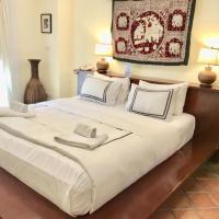Nirvana Boutique Suites, отель в городе Джомтьен-Бич