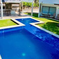 Viesnīca Casa con Alberca Junto al Lago pilsētā Tekiskiapana