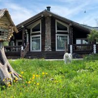 Baikal village eco-lodge, отель в городе Новоснежная