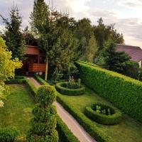 Verde Land - Drewniany domek na wsi, hotel in Osiek Mały