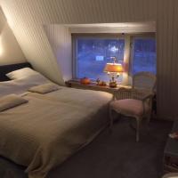 Gezellige zolder in Wassenaar met dakterras, hotel in Wassenaar