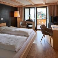 Hotel Alphorn, отель в городе Гштад