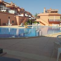 Apartamento con amplia piscina en zona tranquila