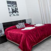 Etna Catania Center </h2 </a <div class=sr-card__item sr-card__item--badges <div class= sr-card__badge sr-card__badge--class u-margin:0  data-ga-track=click data-ga-category=SR Card Click data-ga-action=Hotel rating data-ga-label=book_window: 10 day(s)  <span class=bh-quality-bars bh-quality-bars--small   <svg class=bk-icon -iconset-square_rating fill=#FEBB02 height=12 width=12<use xlink:href=#icon-iconset-square_rating</use</svg<svg class=bk-icon -iconset-square_rating fill=#FEBB02 height=12 width=12<use xlink:href=#icon-iconset-square_rating</use</svg<svg class=bk-icon -iconset-square_rating fill=#FEBB02 height=12 width=12<use xlink:href=#icon-iconset-square_rating</use</svg </span </div   <div class=m-badge m-badge__preferred m-badge__preferred--moved m-badge__preferred--small <span data-et-view=TPOaXGZCHQGPGJIMADXRT:1</span <svg aria-hidden=true class=bk-icon -iconset-thumbs_up_square  pp-icon-valign--inherit fill=#FEBB02 height=20 rel=300 width=20<use xlink:href=#icon-iconset-thumbs_up_square</use</svg </div <div class=sr-card__item__review-score style=padding: 8px 0  <div class=bui-review-score c-score bui-review-score--inline bui-review-score--smaller <div class=bui-review-score__badge aria-label=Punteggio di 8,2 8,2 </div <div class=bui-review-score__content <div class=bui-review-score__title Ottimo </div <div class=bui-review-score__text 150 recensioni </div </div </div   </div </div <div data-component=deals-container data-deals=[] data-deals-other=[] data-layout=horizontal data-max-elements=3 data-no-tooltips=1 data-use-drawer= data-prevent-propagation=0 class=c-deals-container   <div class=c-deals-container__inner-box    </div </div <div class=sr-card__item   data-ga-track=click data-ga-category=SR Card Click data-ga-action=Hotel location data-ga-label=book_window: 10 day(s)  <svg aria-hidden=true class=bk-icon -streamline-geo_pin sr_svg__card_icon focusable=false height=12 role=presentation width=12<use xlink:href=#icon-streamline-geo_pin</use</svg <div