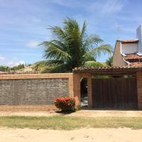 Casa de Veraneio, com piscina, churrasqueira, área de lazer, três suites com ar condicionado a 100m da praia, na Barra de São Miguel-AL