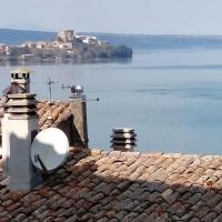 Appartamento nel borgo medievale con vista lago, hotel a Marta