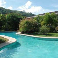 Apt Carlton Beach Tahiti - by Tahiti Villas, отель в городе Aua