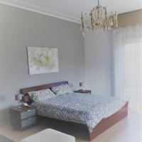 Bella Vita Guesthouse, hotel ad Arona