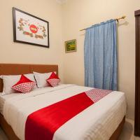 OYO 719 Penginapan Panatapan Almonsari Resort, hotel di Banualuhu