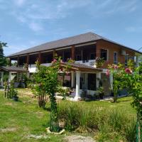 ESCAPE BED N BEACH, hotel in Kampong Bari Kechil